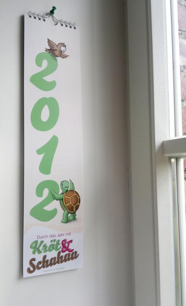 Der Streifenkalender von Kröt und Schuhuu für das Jahr 2012 wie er bei mir hängt.