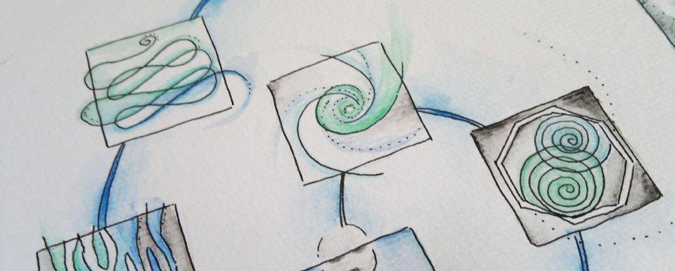 Vermalt mit Wasser verlaufen die Farben auf dem Aquarellpapier.