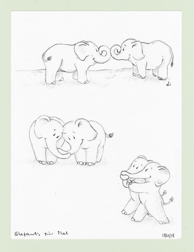 Zwei kleine Elefanten, die sich sehr gern haben.
