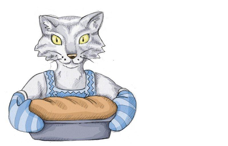 Nach 45 Minuten im Ofen holt Louise, die Katzenbäuerin das duftende Brot aus dem Ofen.