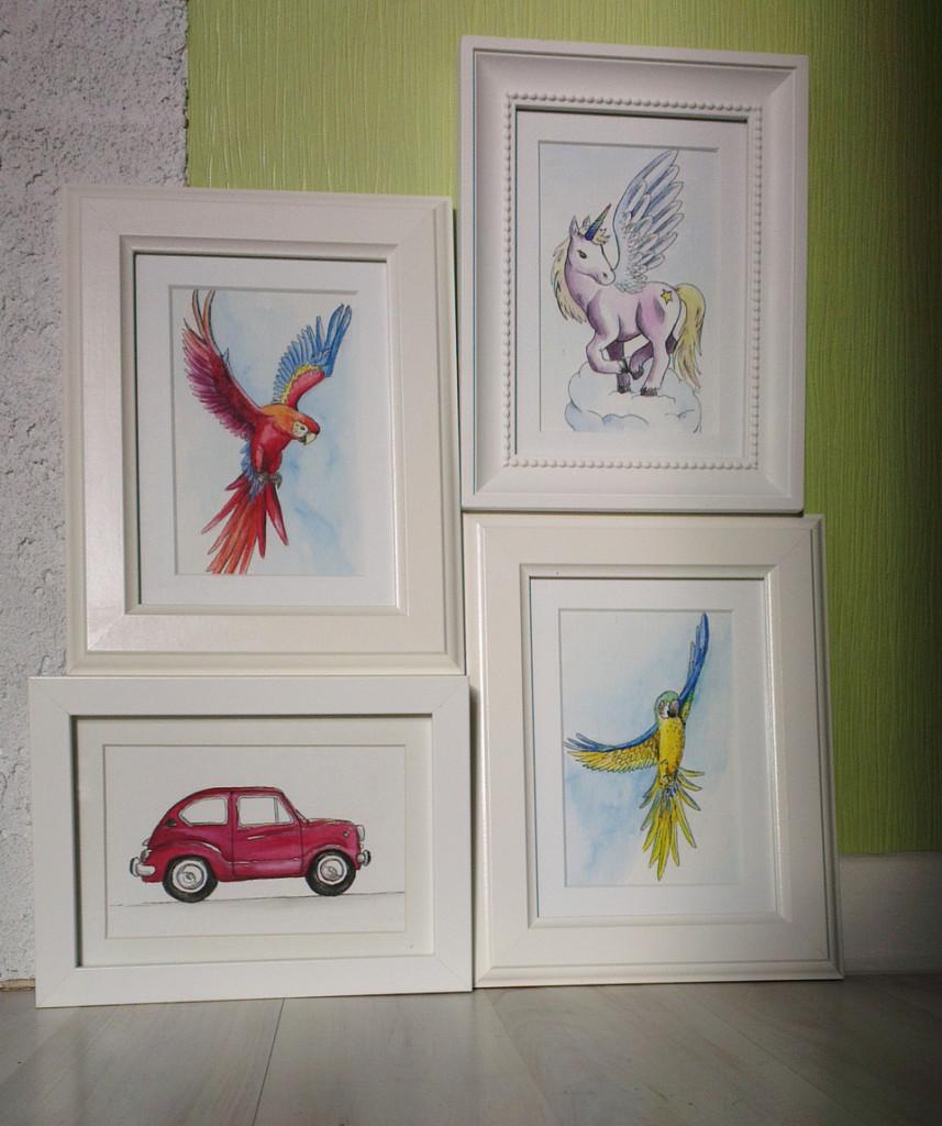 Vier Osterhasen ready for Versteckeln – die Aquarell-Bilder in weißen Rahmen mit Passepartout.