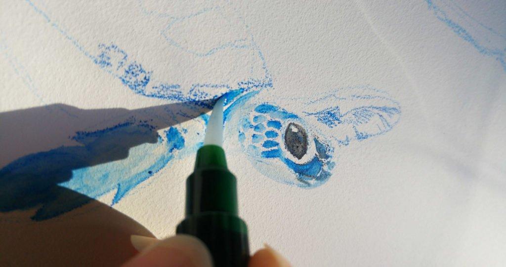 Vermalen der Pigmente mit eine Wassertankpinsel.