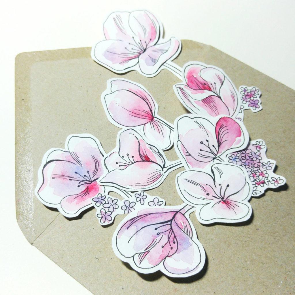 Ein Briefumschlag voller Blüten.