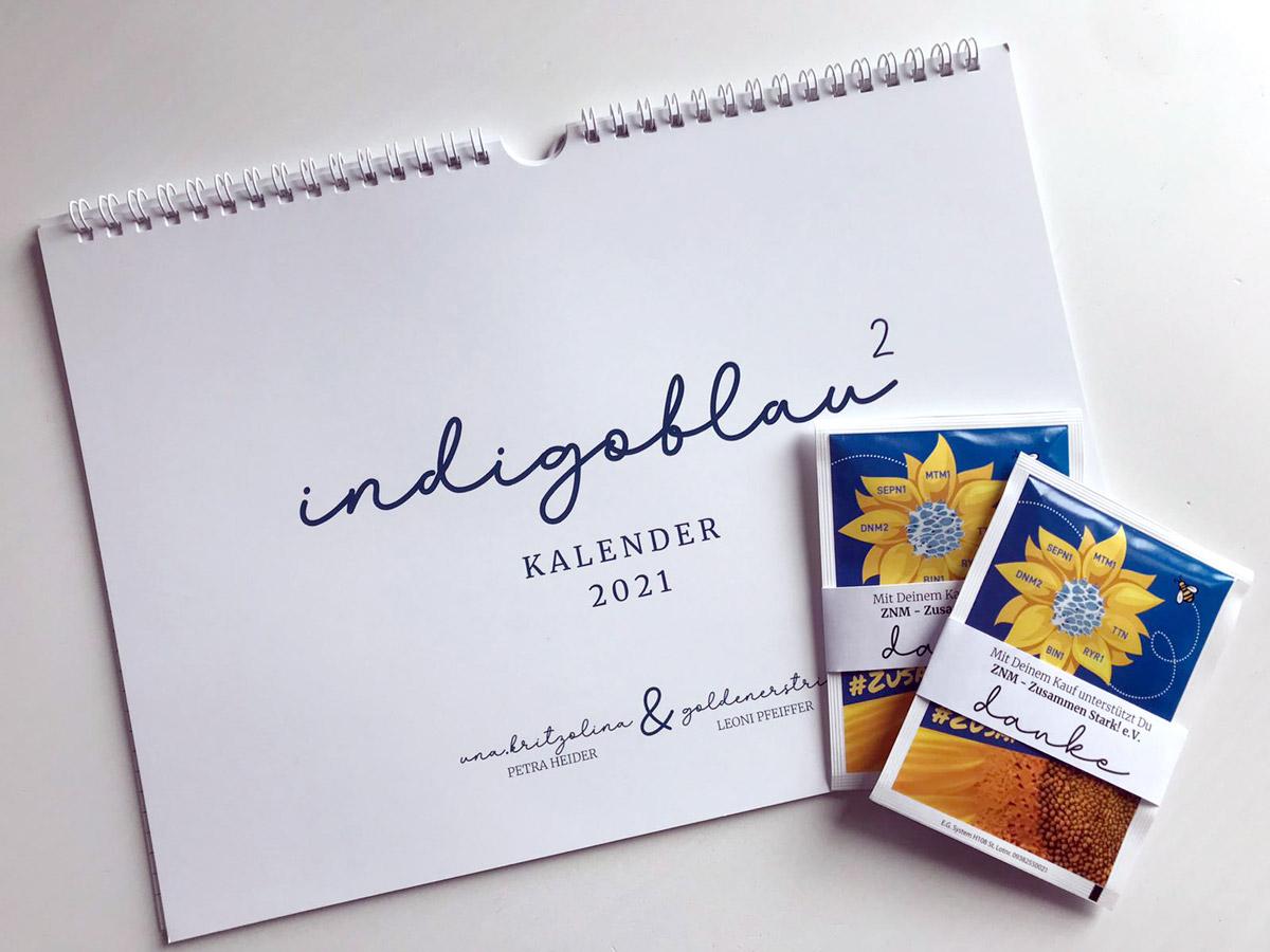 """Mit dem Wandkalender """"Indigoblau hoch 2"""" bekamen die Käufer und Spender einen Sonnenblumen-Samentüte von ZNM - Zusammen Stark! e.V."""