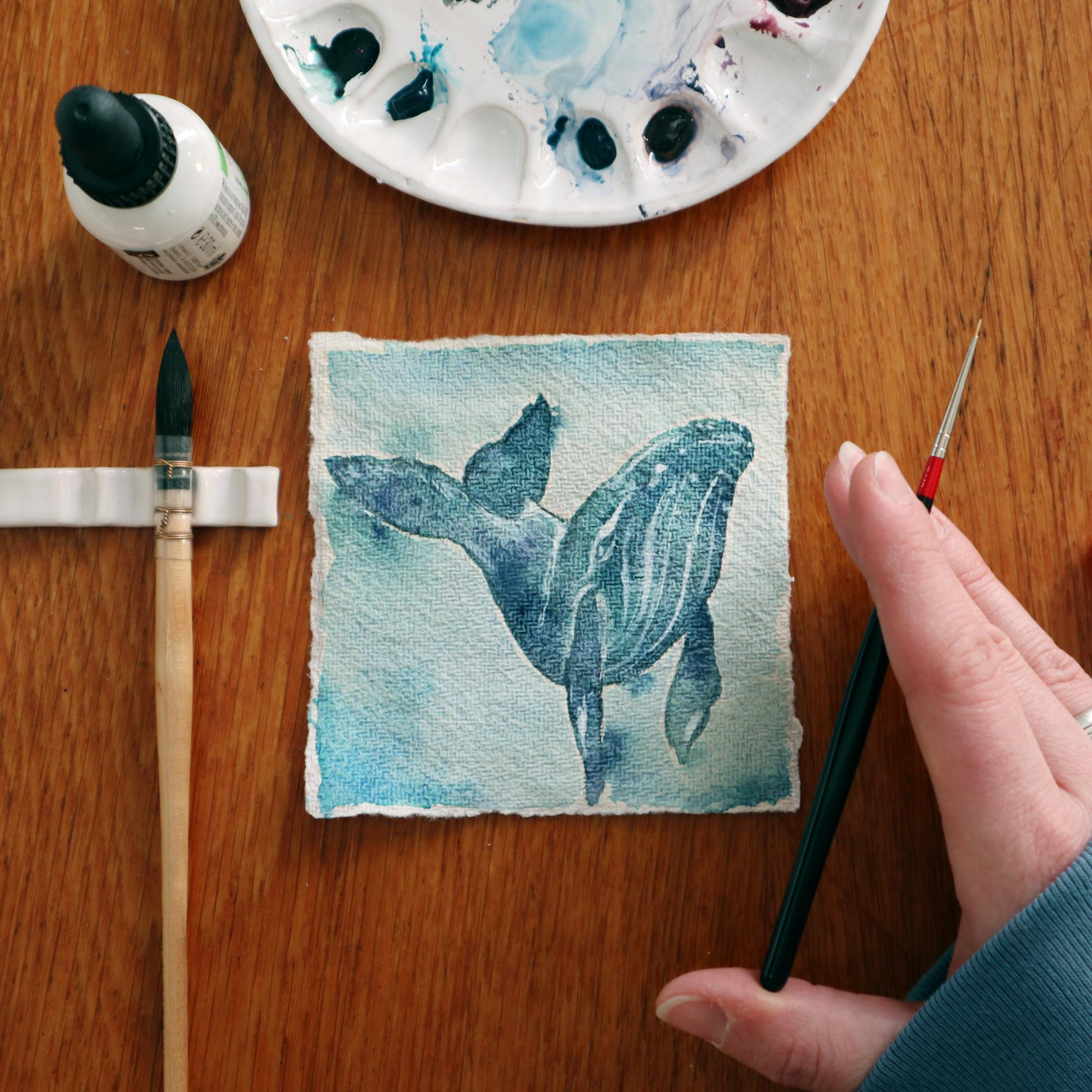 Ein Buckelwal auf der starken Struktur des handgeschöften Echt Bütten Aquarellpapiers.