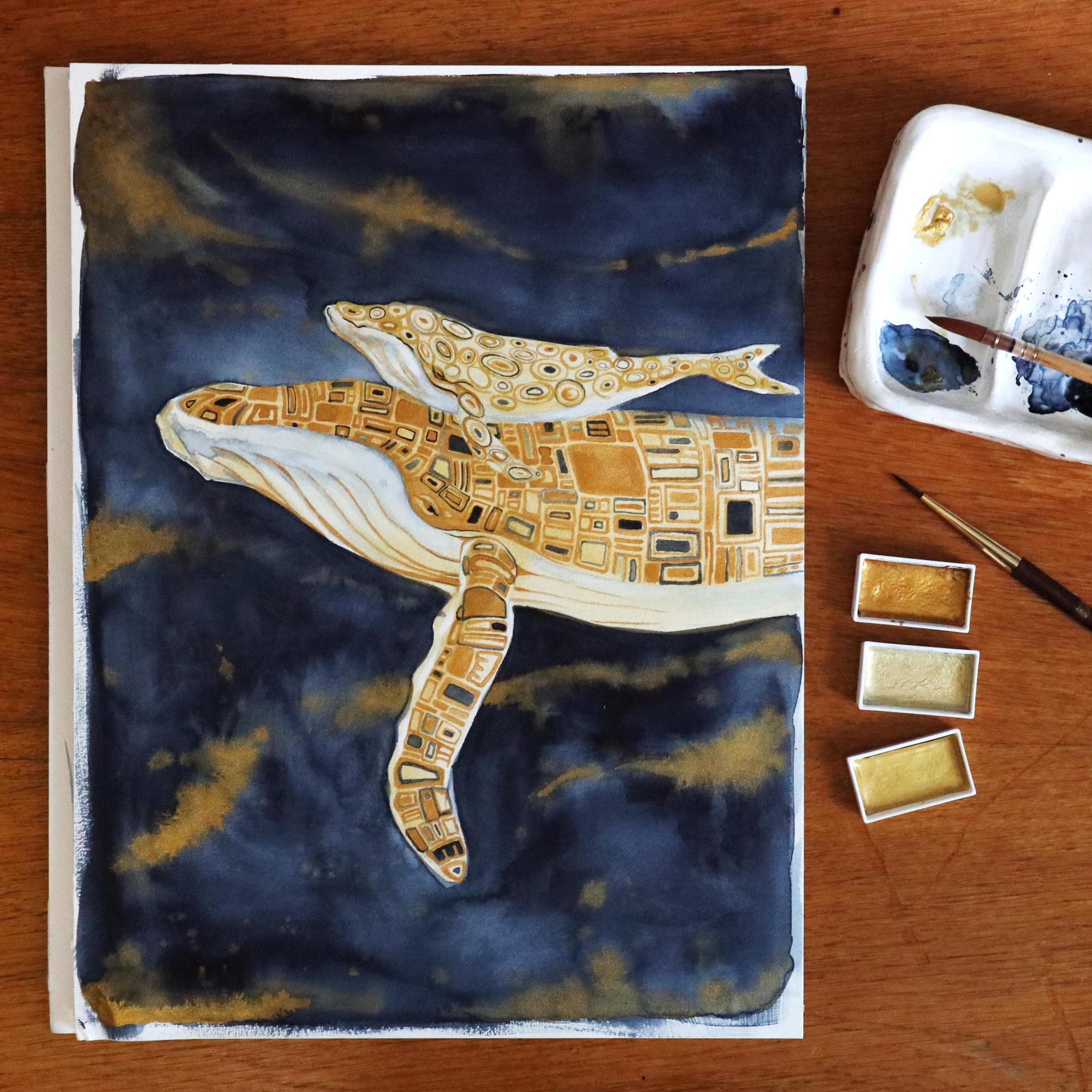 Das fertige Bild mit den beiden goldenen Walen vor einem indigofarbenen Hintergrund.