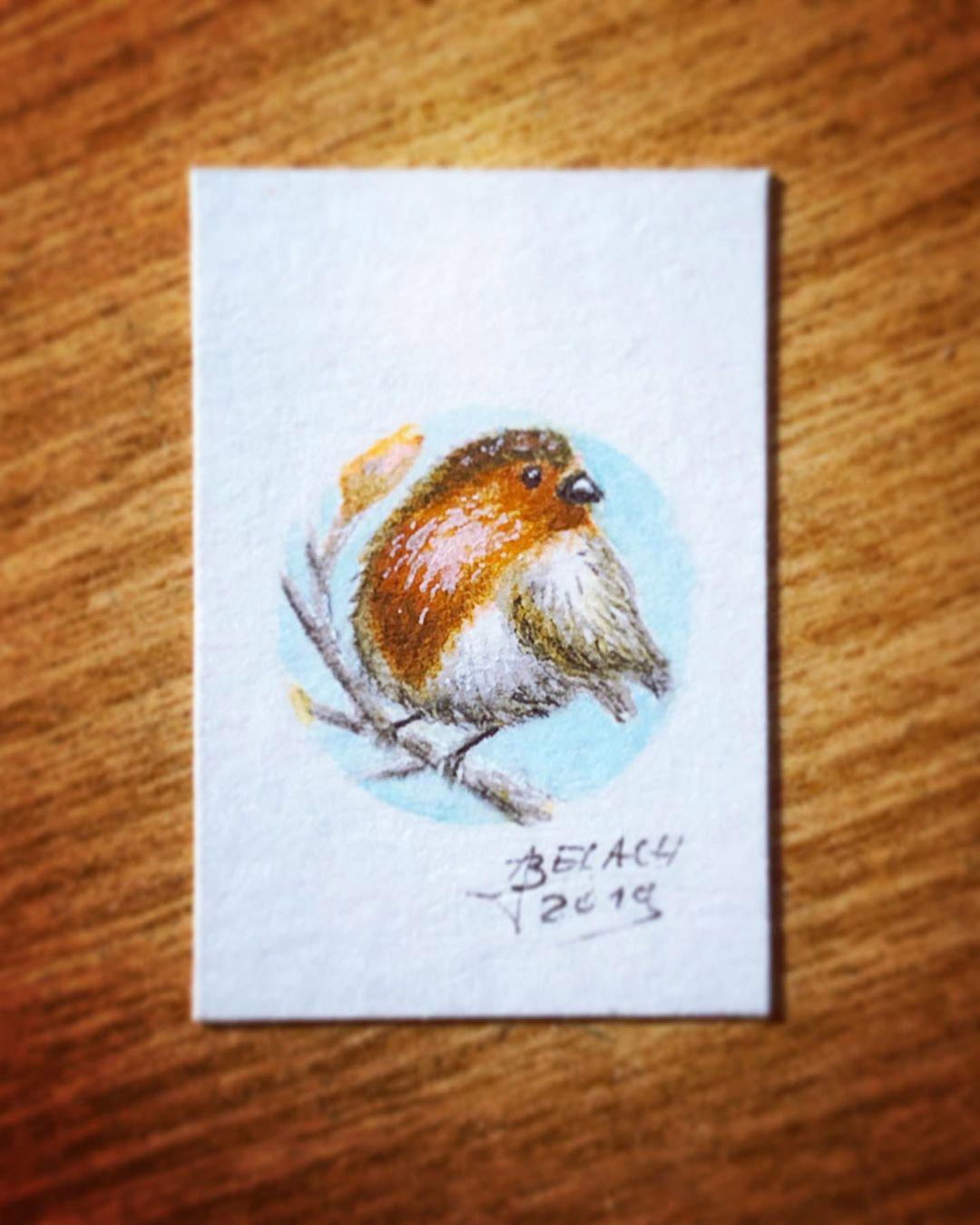 Macroaufnahme des Centpaintings: Ein Miniatur-Rotkehlchen