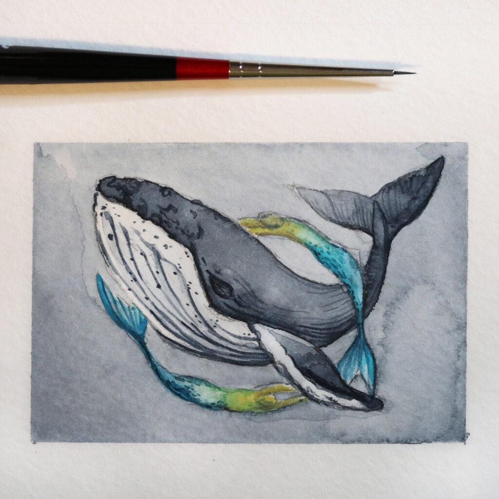 Etwas kleiner als eine Kreditkarte: Der Wal und die Meerjungfrauen.