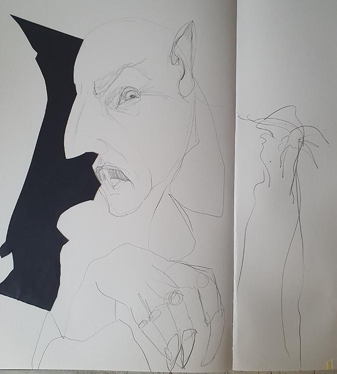 Nosferatus Gesicht an der Papierkante entlang gezeichnet.