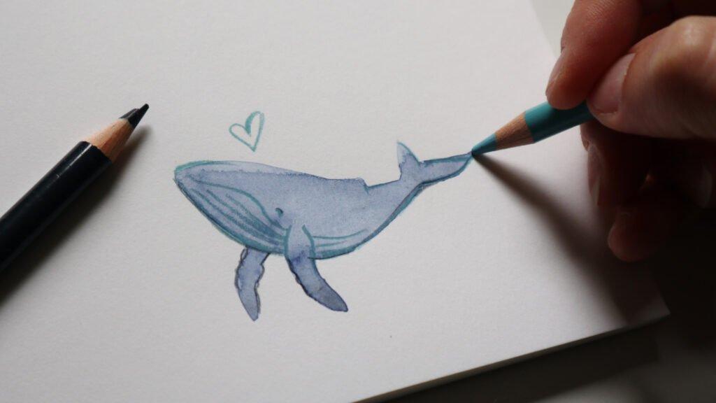 """Ein paar schnelle Linien mit den Buntstiften über einen Aquarell""""fleck"""" und schon ist es ein Wal."""